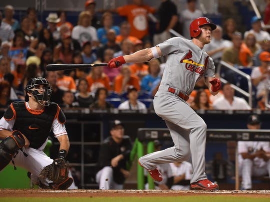St. Louis Cardinals left fielder Jeremy Hazelbaker connects for a two run home run off of Miami Marlins relief pitcher Jose Urena in the second inning Jul 29, 2016, at Marlins Park in Miami.