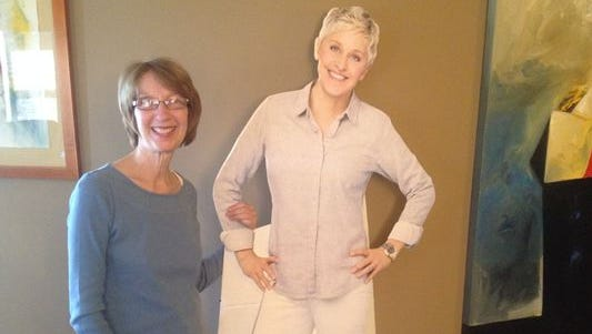 Pamela Shilling of Phoenix poses with a cardboard cutout of her favorite TV star.