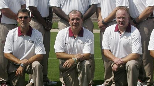 Eddie Gran (left) and Mark Stoops (right) were Florida State assistants together under Jimbo Fisher (center) in 2012.