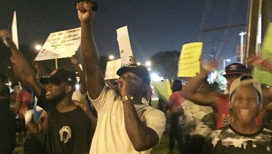 Demonstrators protest in Baton Rouge Friday over the fatal shooting of Alton Sterling by Baton Rouge police officers.