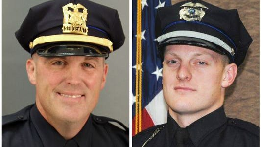 Des Moines police Sgt. Anthony Beminio, left, and Urbandale, Iowa, police Officer Justin Martin were killed Nov. 2, 2016. On Friday, May 19, 2017, Scott Michael Greene, the man accused of killing them, was sentenced to two consecutive life sentences after pleading guilty.