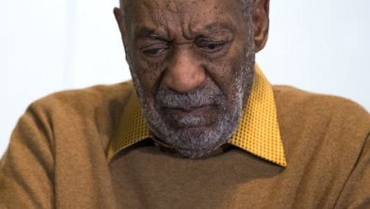 A November 6 file photo shows Cosby pausing during a news conference.