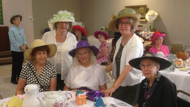 Shown at the recent First Presbyterian Church Mad Hatter Tea Party are (first row, from left) Marie Redman,Patti Wilson and Loweta Rogers; (second row) Marilyn Seel and Peggy Whitcome. Also shown in the far left background is Doris Reeves. More than 175 women attended.