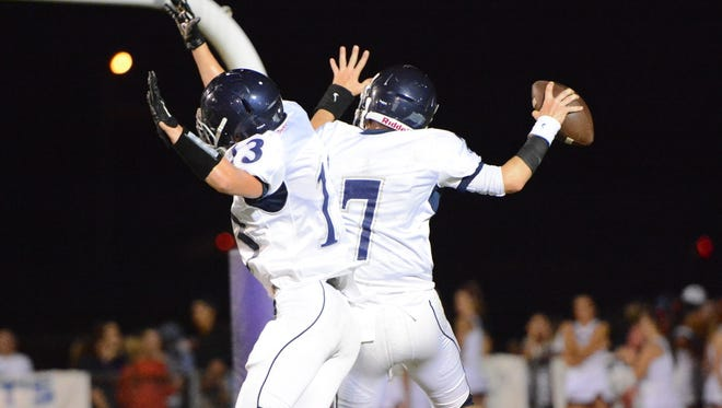 Siegel quarterback Jordan Middleton (7) and wide receiver Matthew Ricks (13) celebrate a touchdown against La Vergne during the Rutherford County Jamboree on Friday at Smyrna.