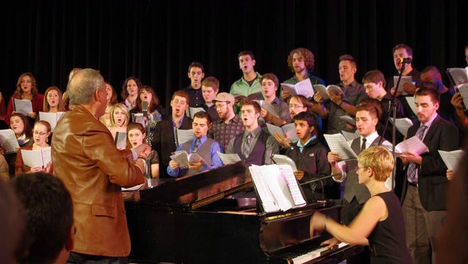 Former Show Choir director Bob Frost leads the Webster High School Alumni Choir. Current Show Choir director Laura D'Angelo provides accompaniment.