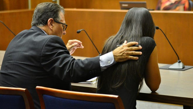 Nicole Lee and her defense attorney as the guilty verdict is read.