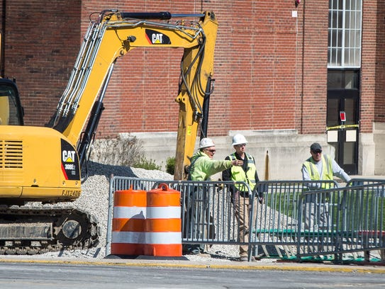 Construction crews start work at the intersection of