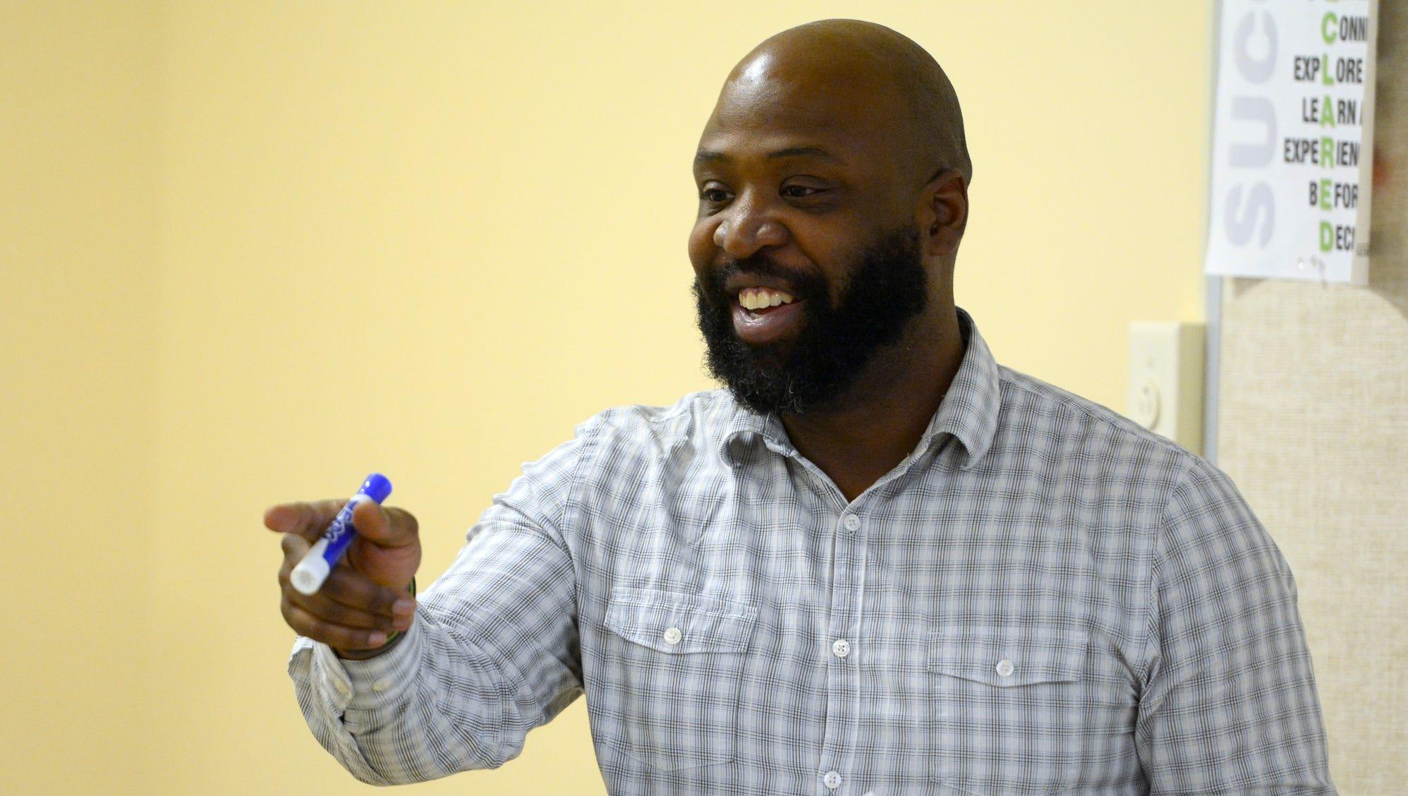 York College rhetoric professor unravels debate