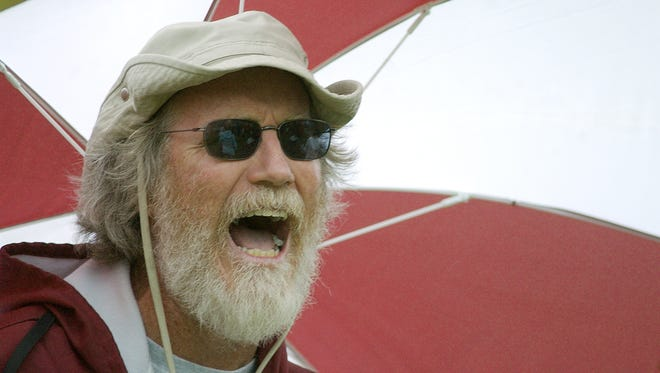 Arlington coach Steve Arnett  calls out to his runners during a cross country competition in this 2007 file photo.
