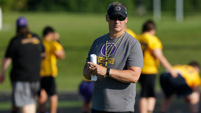Oconomowoc coach Greg Malling supervises his team Tuesday on the first day of football practice.