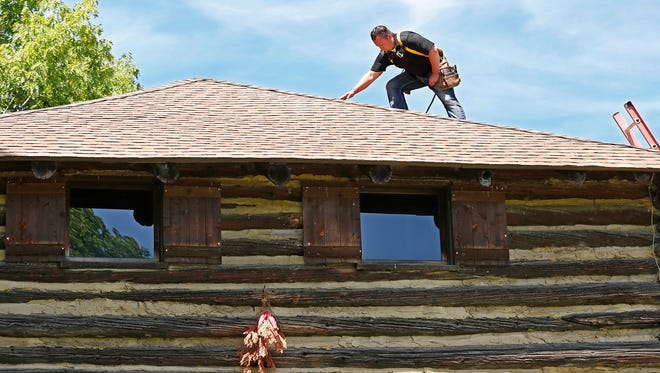 James Shaw performs an inspection of the new roof atop the blockhouse Wednesday, May 23, 2018, at Fort Ouiatenon. Shaw is with Flint Run Builders.