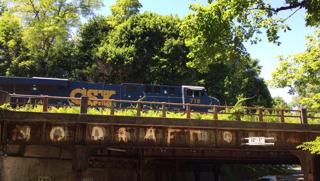 A CSX train passes a bridge in Brighton defaced with the same graffiti for nearly 50 years.