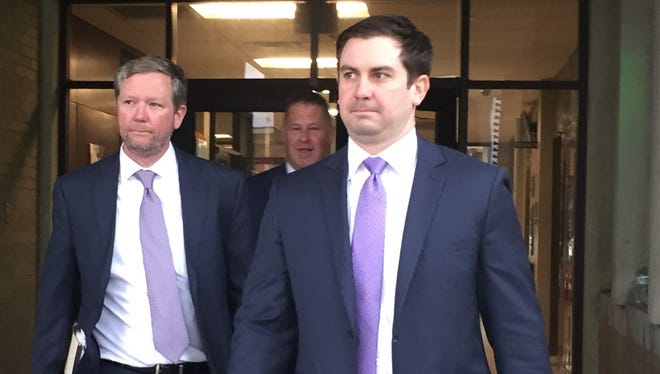 Lafayette City Marshal Brian Pope, center, leaves the Lafayette courthouse with his attorneys after a Dec. 27, 2017, hearing.