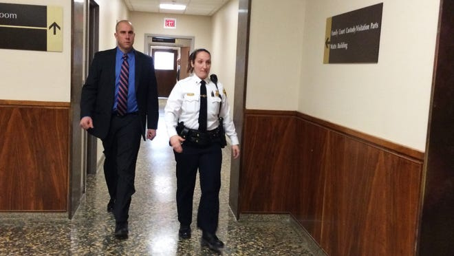 Rochester police officer Michael DiPaola enters court to testify during a hearing on Jan. 20 in regards to Thomas Johnson III case.