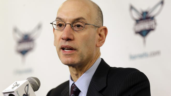 File: NBA commissioner Adam Silver talks to the media before an NBA basketball game.