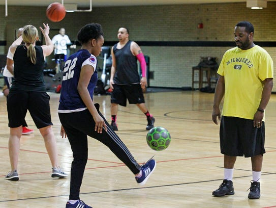 Kamryn Gayle, 13, practices soccer drills with her