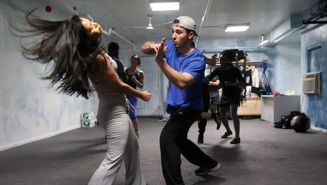 Stunt school students Rosa Krystle and Francis Volpe from Mamaroneck, work on their fight moves at the UATW Stunt School in New Rochelle.