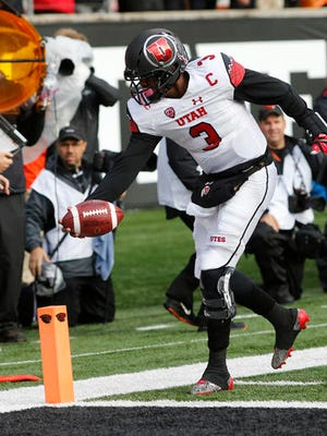 Utah quarterback Troy Williams (3) reaches the ball to the end zone for a touchdown during the second half of an NCAA college football game against Oregon State in Corvallis on Saturday. Utah won 19-14.