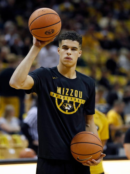 FILE - In this Nov. 10, 2017, file photo, Missouri's Michael Porter Jr. warms up before the start of an NCAA college basketball game against Iowa State, in Columbia, Mo. Michael Porter Jr. will miss the remainder of the season after undergoing lower back surgery, the school has announced. The 6-foot-10 Porter, the top prep prospect in the country last season, played in only two minutes of the Tigers' season-opening win over Iowa State before missing the last three games with the injury. He will undergo surgery on Tuesday, Nov. 21, 2017, in Dallas, and his expected recovery time is three to four months.(AP Photo/Jeff Roberson, File)