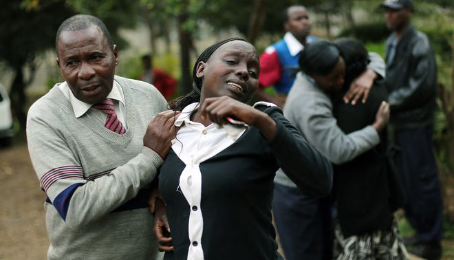 Relatives of Johnny Mutinda Musango, 48, weep after identifying his body at the city morgue in Nairobi, Kenya, on Sept. 24.