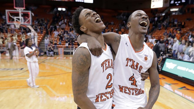 UTEP guards Omega Harris, left, and Lee Moore celebrate after Thursday's 78-73 win over Southern Miss in their Conference USA matchup at the Don Haskins Center.