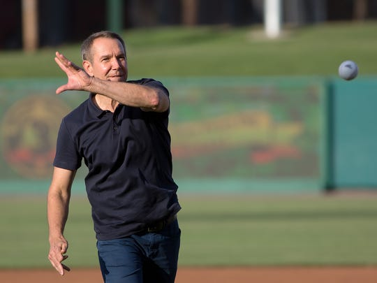 Artist Jeff Koons throws out the first pitch to celebrate the 10th anniversary of the York Revolution Friday.