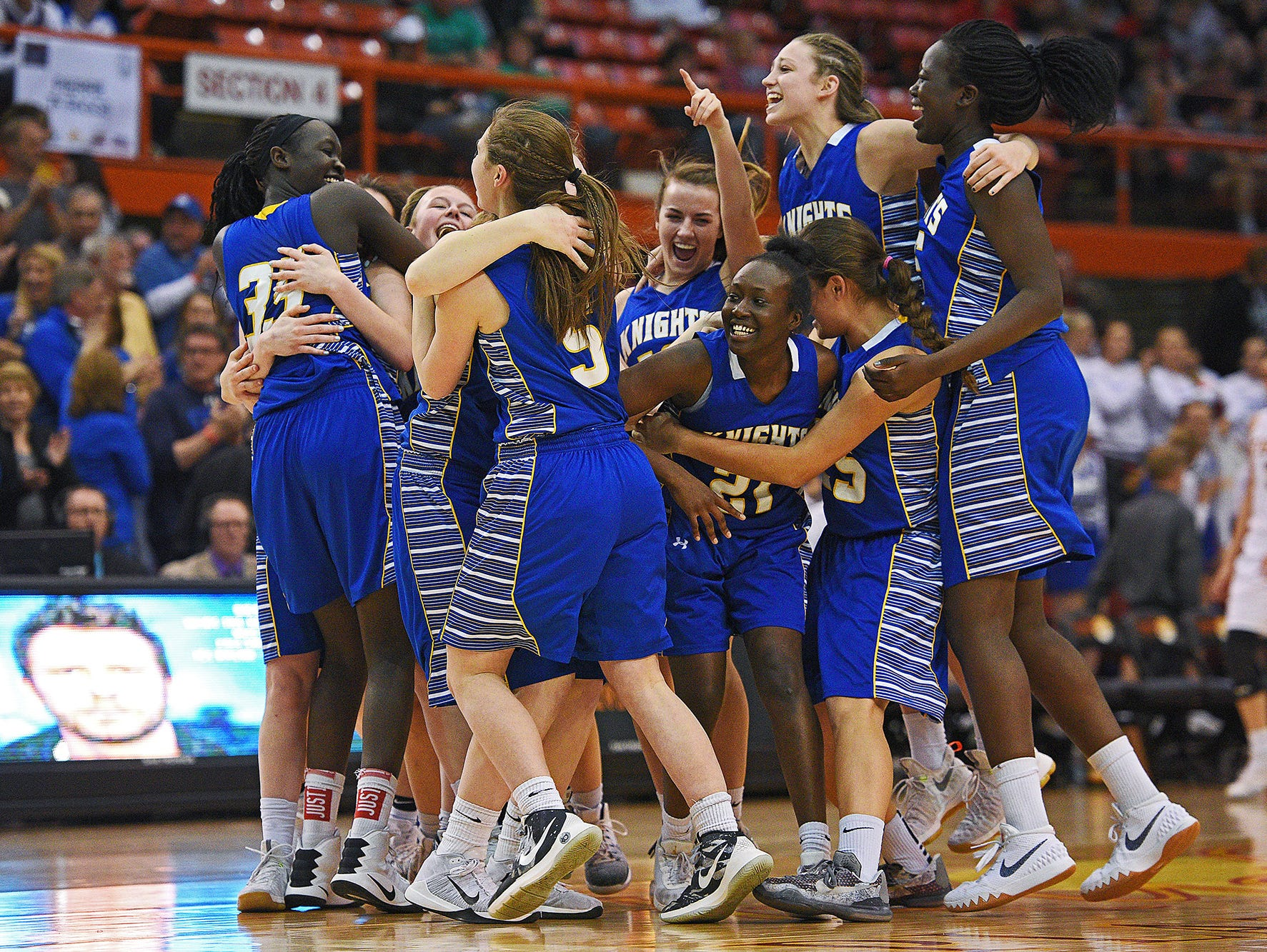 O'Gorman players celebrate their team's 53-48 overtime win over Harrisburg in the 2017 SDHSAA Class AA State Girls Basketball championship game Saturday, March 18, 2017, at Rushmore Plaza Civic Center in Rapid City.