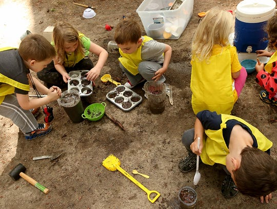 Magnolia Forest Preschool campers play in the mud at Kitsap Memorial Park in Poulsbo.