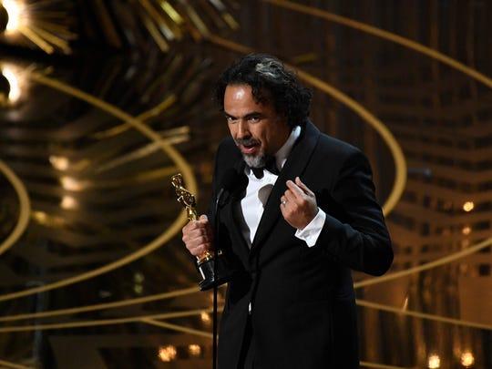 Alejandro Gonzalez Inarritu accepts the Oscar for Best