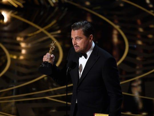 Leonardo DiCaprio accepts the Oscar for Best Actor