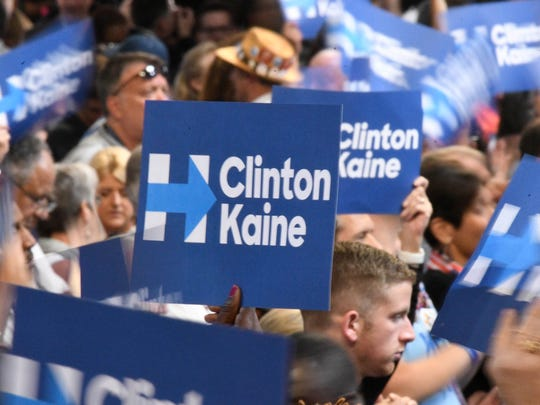Convention-goers hold up signs supporting Hillary Clinton