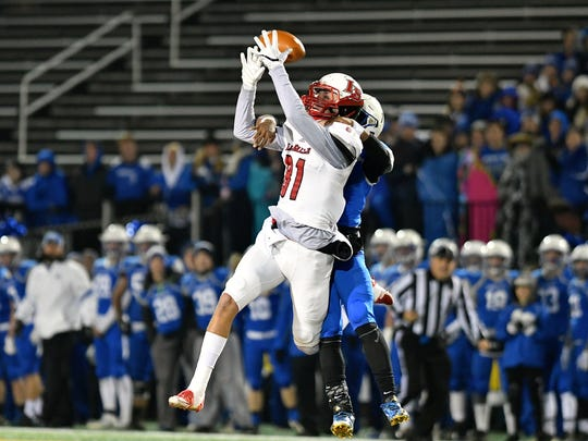 Josh Whyle goes up for a pass in the first quarter against Anthony Wayne.