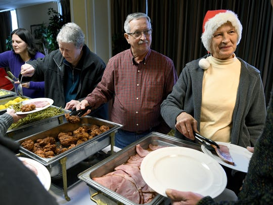 Hope Reagan, right, Jerry Rawlings, Mary Jean Bradley and Tammie Sink, members of  Banner Baptist Church congregation, serve lunch to those attending the Douglas Cooperative Christmas Party for adults with disabilities Dec. 14, 2016. The church lost its fellowship hall in the fire, including items for the party that is for adults with disabilities, but was determined to continue the Christmas party, which is a staple of the church's Christmastime ministry work.