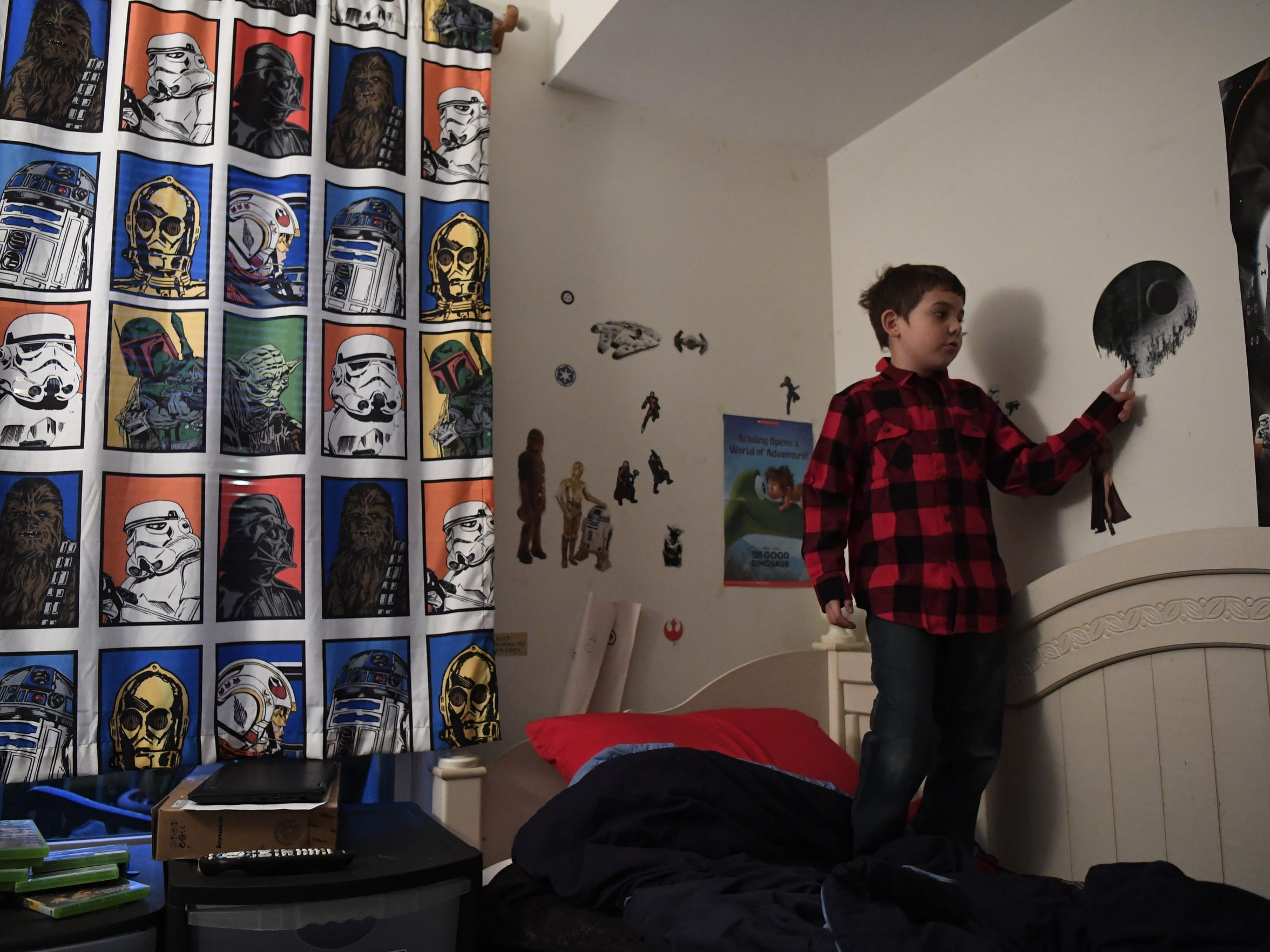 Joe Maldonado, 8, in his room that is filled with Star