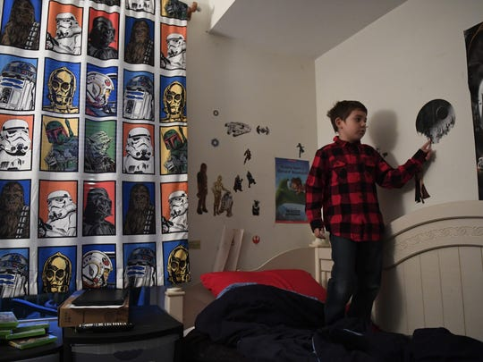 Joe Maldonado, 8, in his room that is filled with Star Wars. Maldonado was kicked out of Secaucus Cub Scout Pack 87 because he was born a girl.