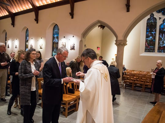 Francis Rooney, newly elected U.S. Congressman, R, Florida, receives communion from Priest Kevin O'Brien at Dahlgren Chapel in Georgetown on Tuesday, Jan. 3, 2017 in Washington, D.C.