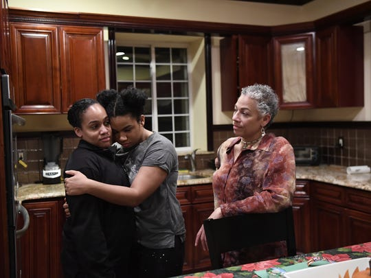 Wé McDonald, center, at home with her sister, Jasmine, and mother, Jaqueline.