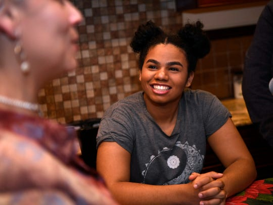 Wé McDonald talking with her mom, Jacqueline, in the kitchen of their Paterson home.