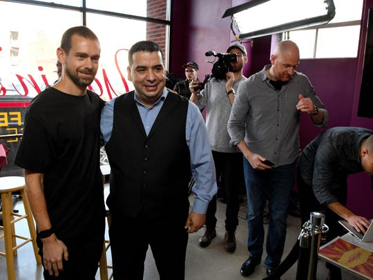 Jack Dorsey, left, CEO of Square and Twitter, poses for a photograph after interviewing Yassin Terou, center, owner of Yassin's Falafel House, as the premiere of a short film project on small business successes Thursday, Jan. 26, 2017.