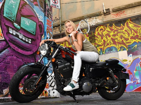 Elena Vesnina from Russia sits on a Harley- Davidson