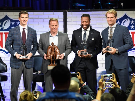 Feb 3, 2017; Houston, TX, USA; From left New York Giants quarterback Eli Manning , NFL commissioner Roger Goodell , Arizona Cardinals receiver Larry Fitzgerald and Carolina Panthers tight end Greg Olsen at a fan forum event with the Walter Payton NFL Man of the Year finalists at the House of Blues in preparation for Super Bowl LI. Mandatory Credit: John David Mercer-USA TODAY Sports