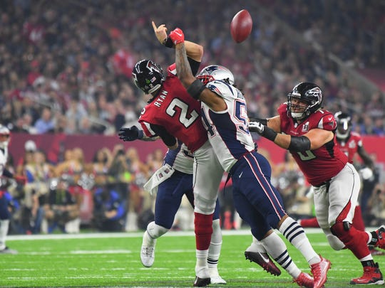 New England Patriots middle linebacker Dont'a Hightower (54) hits Atlanta Falcons quarterback Matt Ryan (2) who fumbles the ball in the fourth quarter, one of the biggest plays of the Super Bowl.