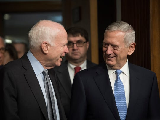 Sen. John McCain, R-Ariz., talks to James Mattis prior