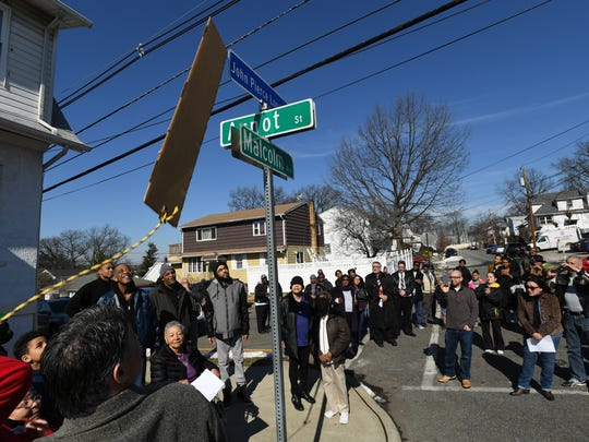 Street dedication for John P. Logan at the intersection of Malcolm Avenue and Arnot Street in Garfield on Saturday, Feb. 18, 2017.