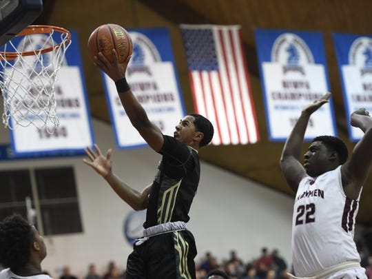 St. Joseph's Chauncey Hawkins lays one in for two in the first half. Don Bosco defeated St. Joseph Regional 67-57 in the Bergen County Jamboree semifinal round at the Fairleigh Dickinson University Rothman Center in Hackensack on Sunday.