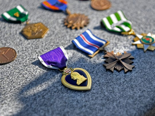 Marine 1st Lt. William Ryan's medals, including the Purple Heart. His son, Michael, keeps these and other mementos of his father. Billy Ryan, originally of Bogota, will finally have a proper burial on May 10 after his remains were found in Laos.
