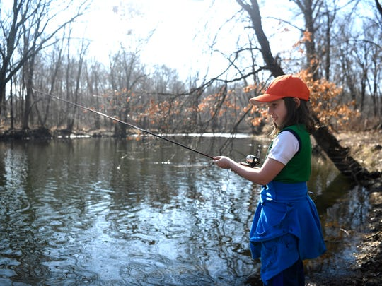 Olivia Evans, 10, of Fairlawn, fishes along the river at the Ramapo Reservation in Mahwah, NJ on Thursday, February 23, 2017. Temperatures reached a high of 70 degrees across North Jersey for some unusually warm February weather.