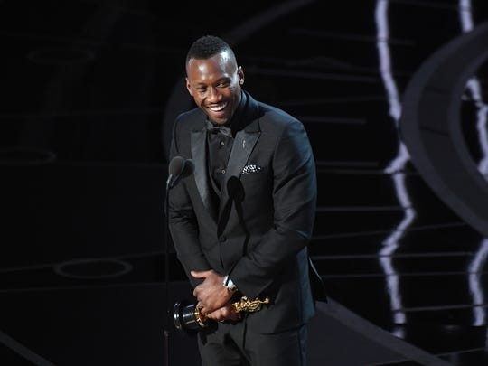 Mahershala Ali accepts the the Oscar for best supporting actor for his role in 'Moonlight' during the 89th Academy Awards.