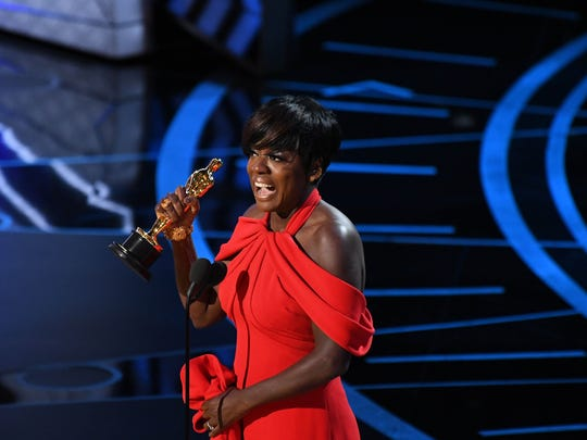 Viola Davis hoists the Oscar for Best Supporting Actress for her role in 'Fences.'