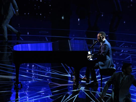John Legend sings a medley of the Oscar-nominated songs